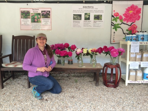 Kasha and her beautiful display of peonies under our sales tent.